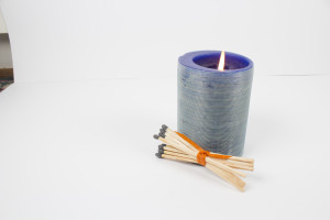 candle and bundle of matches